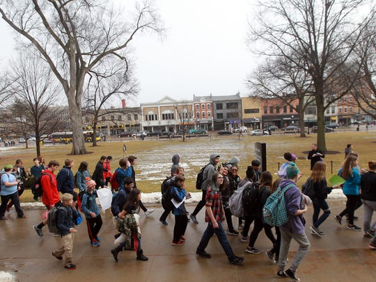 High school and junior high students march to the pedestrian