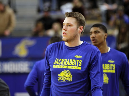 South Dakota State's Mike Daum warms up before the