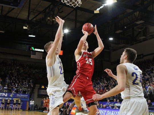 South Dakota's Tyler Hagedorn (25) scores in the paint