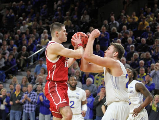 South Dakota State's Mike Daum (right) tries to defend