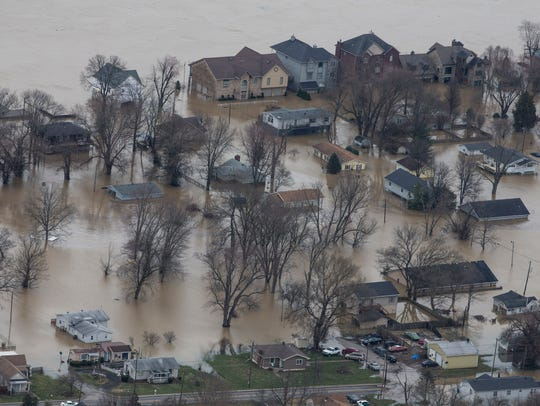 The town of Utica Ind. sits in flood waters of the