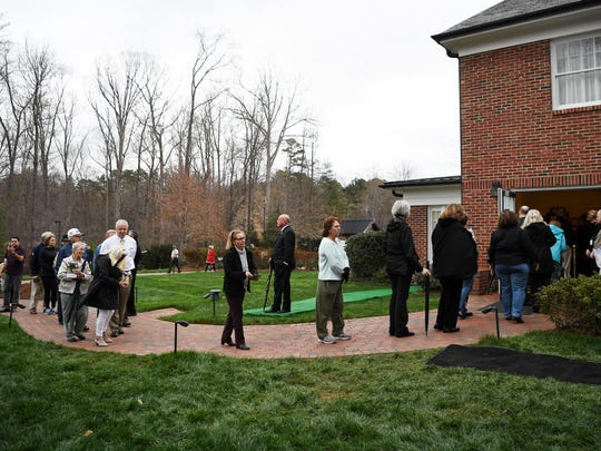 People form a line outside Billy Graham's childhood