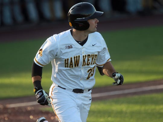 Iowa's Kyle Crowl runs to first base during the Hawkeyes'