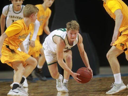 West High's Evan Flitz scoops up a loose ball during