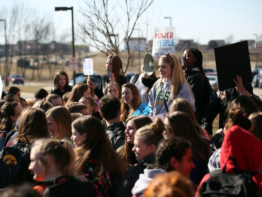North Central Junior High students walk out of class