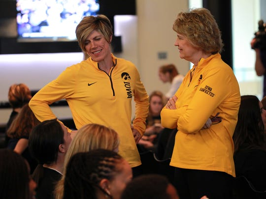 Iowa associate head coach Jan Jensen, left, and head coach Lisa Bluder talk with friends and family after receiving a six seed in the NCAA Tournament on Monday, March 12, 2018.