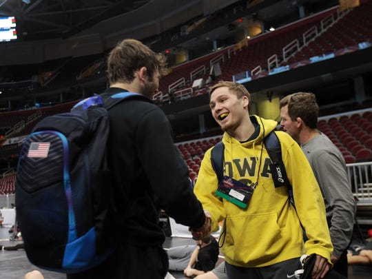 Iowa's Spencer Lee chats with Missouri's Jaydin Eierman during the practice sessions at the NCAA Wrestling Championships at Quicken Loans Arena in Cleveland, Ohio on Wednesday, March 14, 2018.
