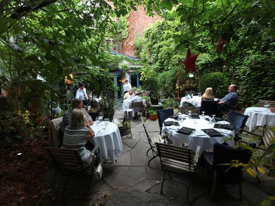 The garden area of Cafe Matisse is located at 167 Park