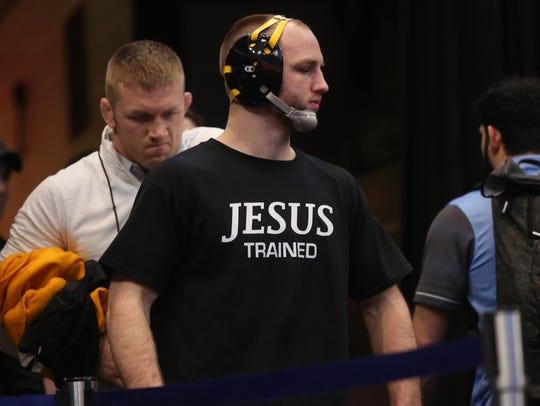 Iowa's Alex Marinelli waits to wrestle Purdue's Jacob