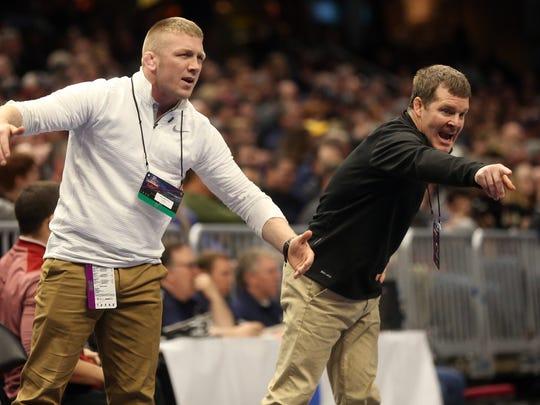 Iowa assistant coach Ryan Morningstar, left, and head