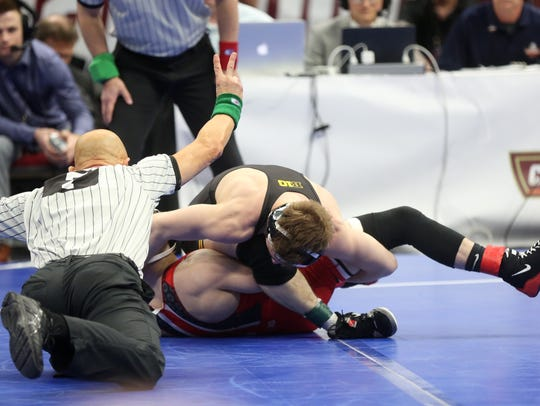 Iowa's Spencer Lee works to pin Ohio State's Nathan