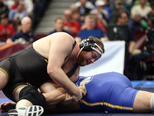 Iowa's Sam Stoll turns Hofstra's Mike Hughes as they wrestle for fifth place at 285 pounds at the NCAA Wrestling Championships at Quicken Loans Arena in Cleveland, Ohio on Saturday, March 17, 2018. Stoll pinned Hughes in 1:57.