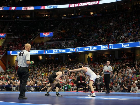 Iowa's Spencer Lee wrestles Rutgers' Nick Suriano in the 125 pound national championship at the NCAA Wrestling Championships at Quicken Loans Arena in Cleveland, Ohio on Saturday, March 17, 2018. Lee won by decision, 5-1.