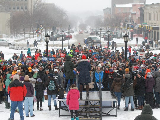 March For Our Lives marchers gather at the Pentacrest on Saturday, March 24, 2018 in Iowa City, Iowa.