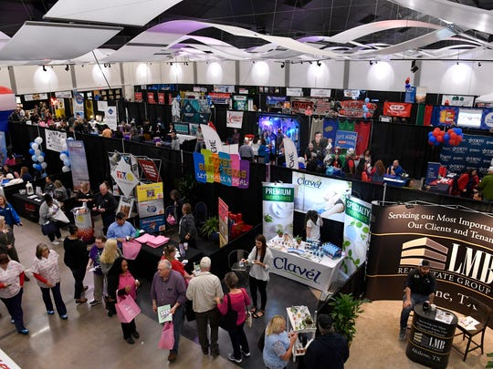 Visitors wander the exhibition hall during the Business