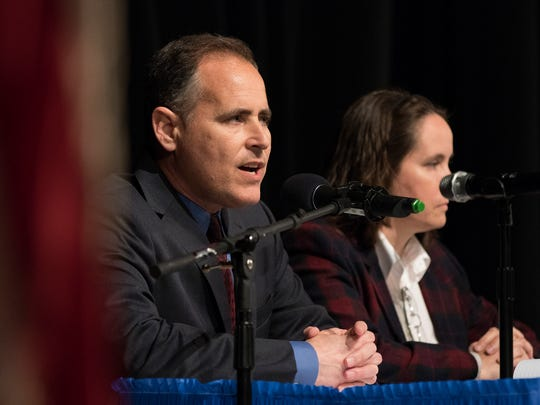 Aaron Starr, left, and Alicia Percell are seen in this 2018 photo at a League of Women Voters candidate forum for the Oxnard recall special election.