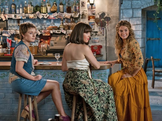 "Young Donna (Lily James, right) forms a band with her best friends Rosie (Alexa Davies) and Tanya (Jessica Keenan Wynn) in the musical sequel ""Mamma Mia! Here We Go Again"" (July 20)."