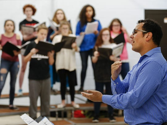 Daniel Gutierrez works with his students in the choir