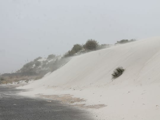 Strong winds blew gypsum at White Sands National Monument Friday afternoon creating a sandy haze on Highway 70.