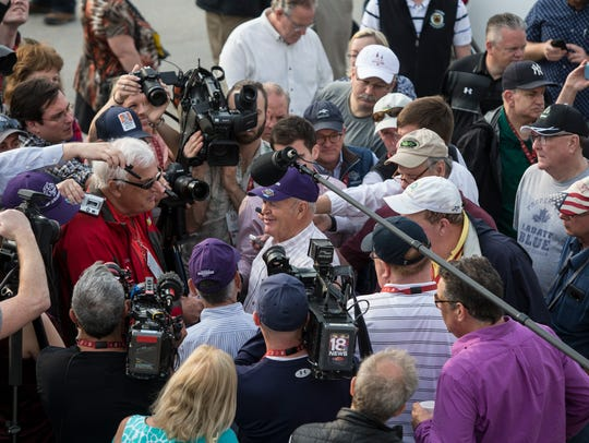 Fred Mitchell is surrounded by the media outside the