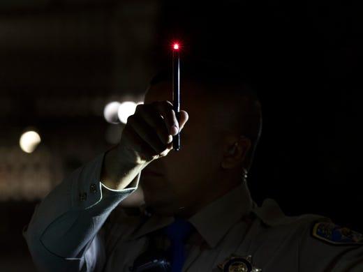 Highway Patrol Officer Benjamin Gomez uses a light