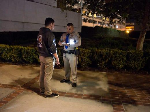 Highway Patrol Officer Benjamin Gomez speaks with an