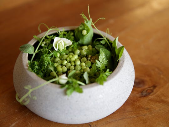 Topped with pea tendrils from Rio Gozo Farm, the Old World Grains salad at gargantua inside Beacon Coffee in Ojai also features sunflower yogurt and unripe blueberries with emmer, brown rice and rye berries.