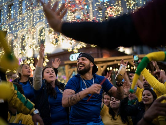 Soccer fans from Brazil dance as they gather on Nikolskaya