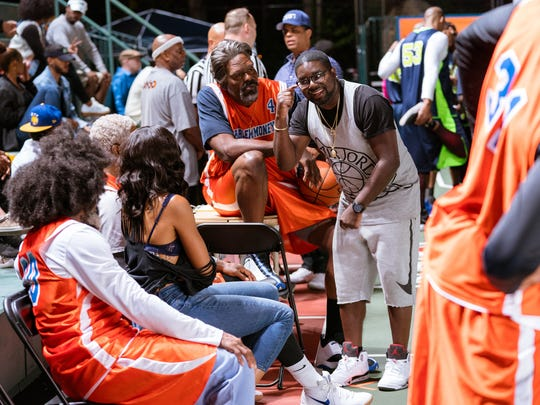As Dax, Lil Rel Howery (center right, with Chris Webber)