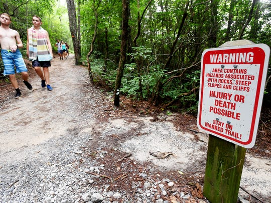 People hike back from Rainbow Falls near Brevard July