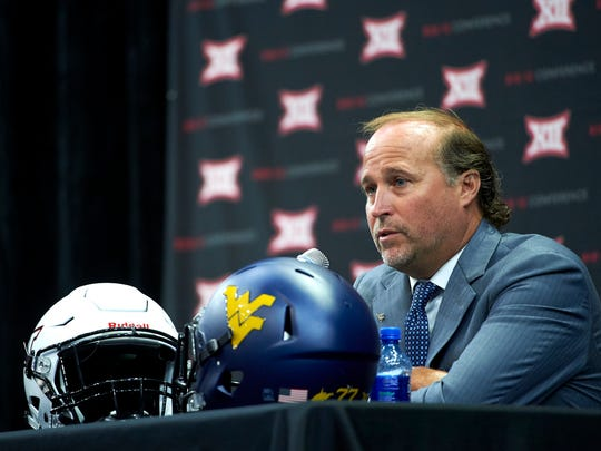West Virginia head coach Dana Holgorsen speaks during