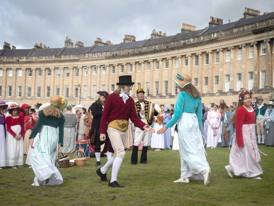 Participants in the annual Jane Austen Regency Costumed Parade dance on the lawn of the historic Georgian Royal Crescent  on Sept. 9, 2017 in Bath, England.