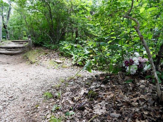 Flowers have been placed at the head of the trail where
