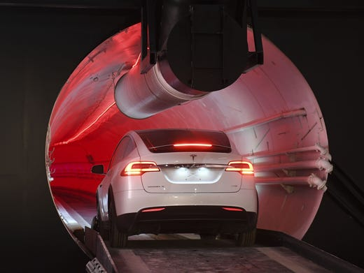 A modified Tesla Model X drives into the tunnel entrance before an unveiling event for The Boring Company Hawthorne test tunnel Pool, Getty Images