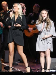 Lennon Stella and Maisy Stella participate in the final US performance by the cast of the TV show Nashville Sunday March 25, 2018 at the Grand Ole Opry.