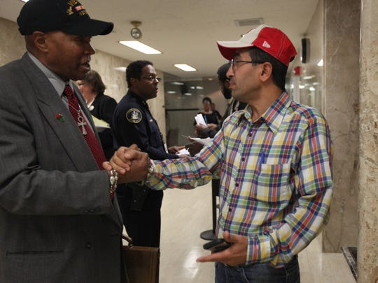 Metro Detroit Cab Drivers Association Kenneth Kabaka Reynolds greets fellow cab Alani, 44 of Detroit after a Detroit City Council meeting regarding regulations for cars for hire on Wednesday, October 15, 2014