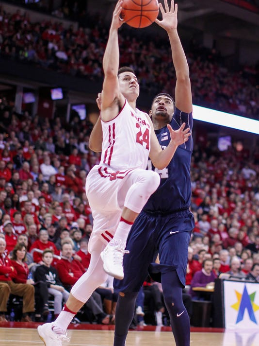 Wisconsin's Bronson Koenig (24) shoots in front of Penn State's Julian Moore (44) during the second half of an NCAA college basketball game Tuesday, Jan. 24, 2017, in Madison, Wis. Wisconsin won 82-55. (AP Photo/Andy Manis)