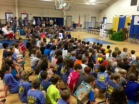 """Alexandria Country Day School students listen to Principal Nancy Rials and Development Committee Chairperson Natalie Monroe on Friday at a reveal ceremony for """"Dancing with the Stars Cenla Style."""""""