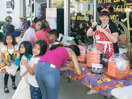 Families participate in the 2016 Harvest Festival at