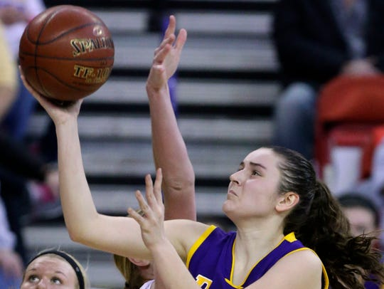 Cudahy's Hannah Kulas makes a shot despite efforts