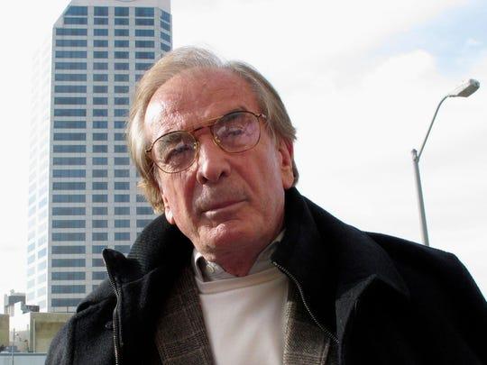 Developer Glenn Straub speaks to reporters after a