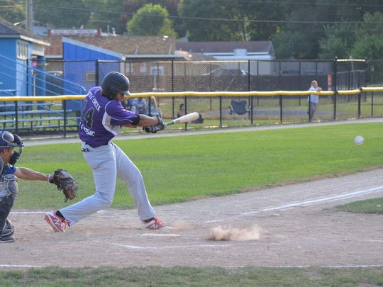 Battle Creek Merchants Brandon Settles takes a swing in the City Major League tourney title game on Monday.
