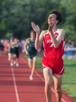 Ocean's Elliot Gindi applauds his own performance as he takes first in the Boys Group 1600 final at the NJSIAA Central Groups 2 and 3 Track and Field Championship at Columbus, NJ on May 27, 2016