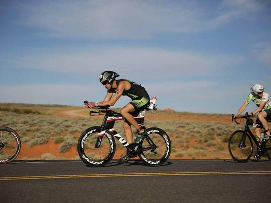 Erik Sorenson tackles the bike portion of the 2015 race of the St. George 70.3 Ironman.