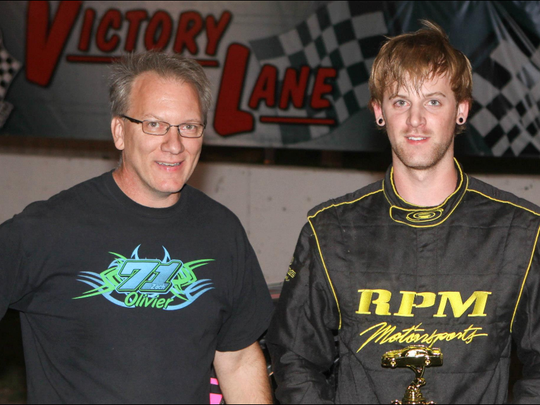 Race car driver Zach Oliver (right) with his dad, Dave.