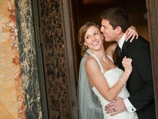 Vanessa Scavone with husband Rob Adams during their wedding.