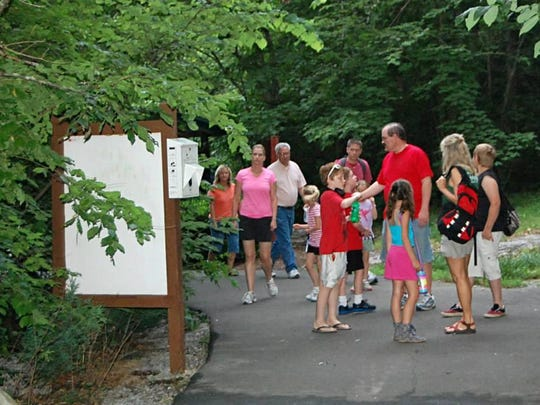"Families learn about critters that come out after the sun goes down in this file photo of a ""What's Up Night Hike."""