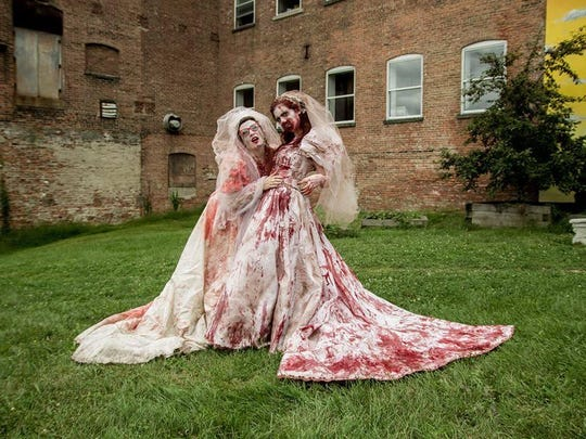 Two zombie brides pose are shown from a past event.