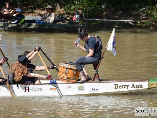 Cajun Invasion paddles on Betty Ann, a double-hull fiberglass boat, imported from Germany that can hold up 20 passengers, and is complete with a dragon's head, a tail and a drum.