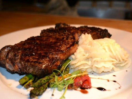 A New York strip steak with whipped potatoes and grilled asparagus at Prime 13 in Point Pleasant.